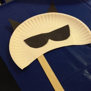 We traced a pair of sunglasses to create the raccoon's mask!